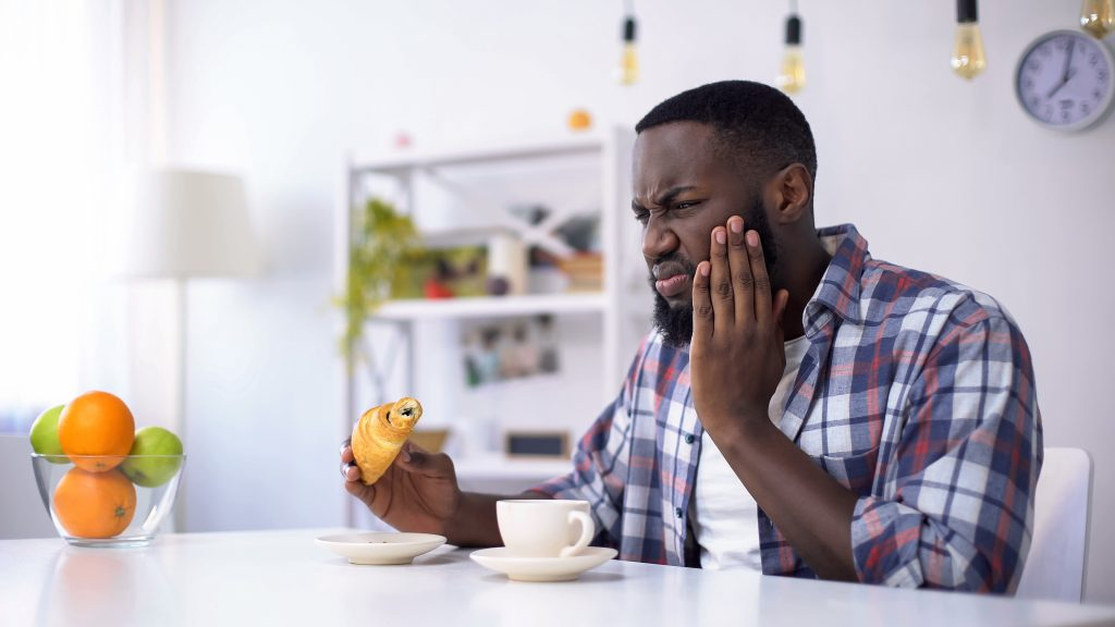 Man With Tooth Pain And Sugary Food 1024x576